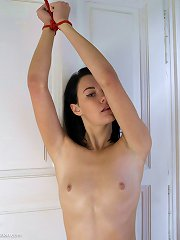 Slut in pantyhose has her arm tied